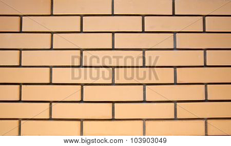 Yellow Facing Brick wall with a very smooth surface. Background or texture