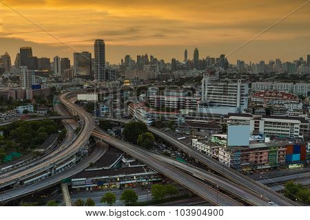 Sunset at Bangkok district main road aerial view