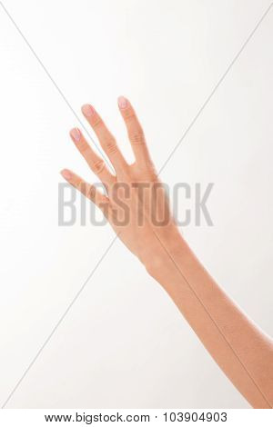 Woman showing four fingers