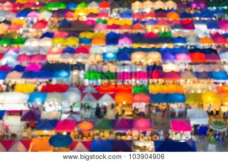Abstract blurred lights of multiple colour aerial view city flea market