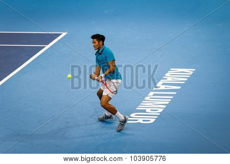 KUALA LUMPUR, MALAYSIA - SEPTEMBER 26, 2015: Christian Oliver Lee of Malaysia plays in his qualifying match in the Malaysian Open 2015 Tennis tournament held at the Putra Stadium, Malaysia.