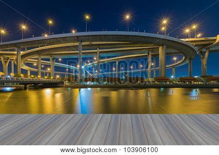 Opening wooden floor, water front view of Bangkok ring road