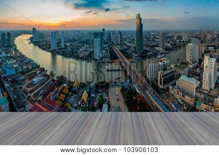 Opening wooden floor, beautiful sunset at Bangkok river curved skyline
