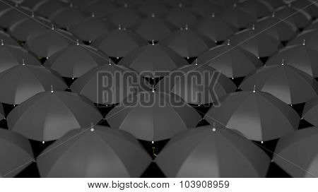 Classic large black umbrellas tops background, focus on center.