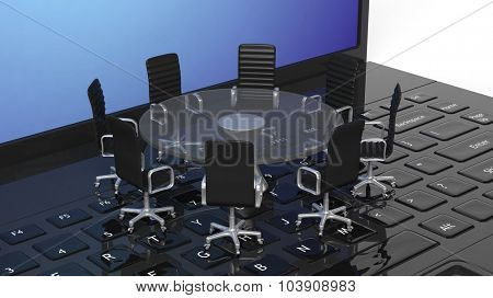 Laptop with round glass meeting table with chairs on the keyboard