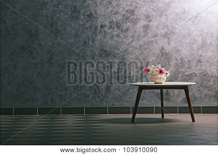 Table with flowers on grey wall background