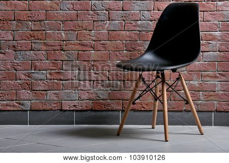 Chair on brick wall background