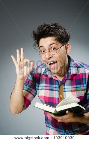 Funny student with many books