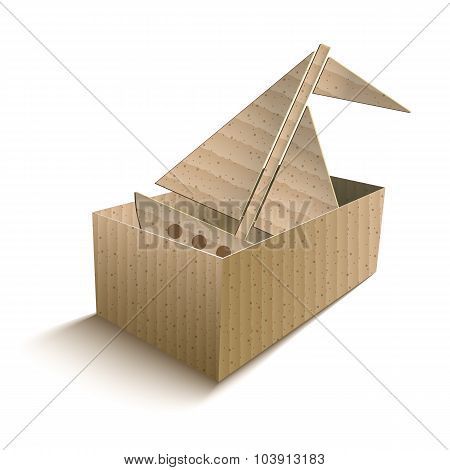 Toy boat in an open cardboard box