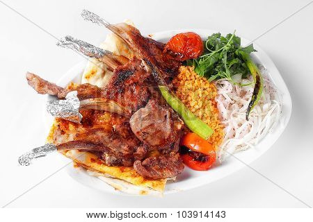 Grilled Lamb Ribs With Herbs And Pide Served Over White Plate