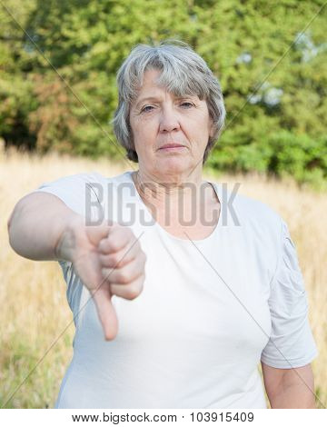 Old age woman showing thumbs down