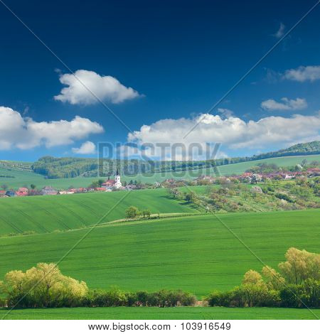 Little town on the green hills, blue sky, beautiful buildings and nature, traditional architecture, summer vacation concept, Europe, Czech Republic