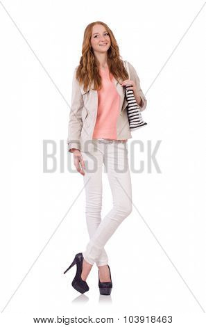 Cute smiling girl in light short coat with hanbag isolated on white