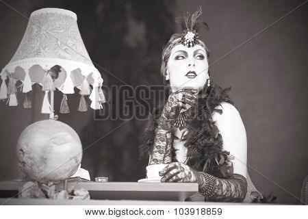 Retro Woman 1920S - 1930S Sitting With In A Restaurant Holding A Cup Of Tea