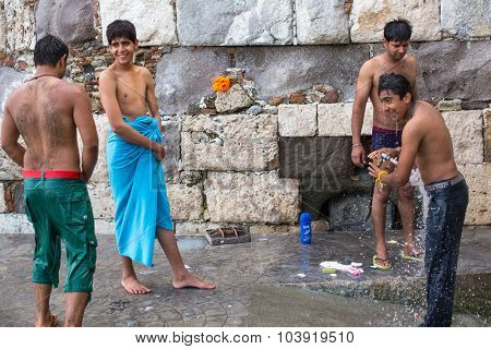 KOS, GREECE - SEP 28, 2015: Unidentified war refugees wash up on the beach. Kos island is located just 4 kilometers from the Turkish coast, and many refugees come from Turkey in an inflatable boats.