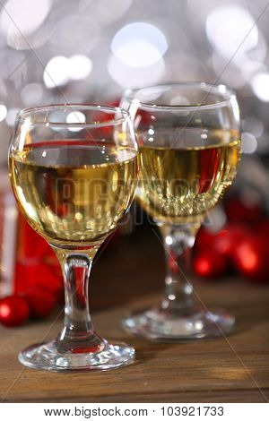 Champagne and Christmas decoration on bright background