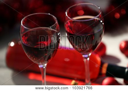 Wine and Christmas decoration on wooden table