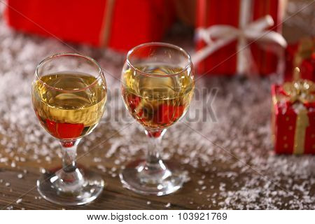 Champagne and Christmas decoration on wooden table