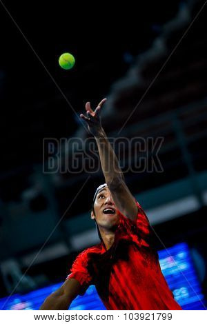 KUALA LUMPUR, MALAYSIA - SEPTEMBER 27, 2015: Yasutaka Uchiyama of Japan serves in his qualifying match at the Malaysian Open 2015 Tennis tournament held at the Putra Stadium, Malaysia.
