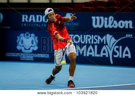KUALA LUMPUR, MALAYSIA - SEPTEMBER 27, 2015: Yasutaka Uchiyama of Japan plays a return in his qualifying match at the Malaysian Open 2015 Tennis tournament held at the Putra Stadium, Malaysia.