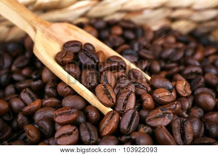 Coffee beans in wattled basket, close up
