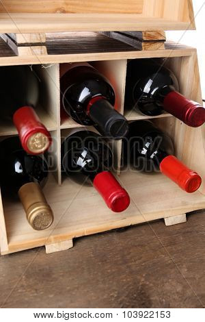 Box with wine bottles on the table