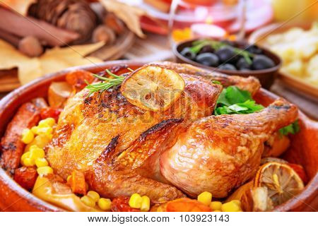Closeup photo of tasty baked turkey in centerpiece of festive table, traditional food for Thanksgiving day holiday