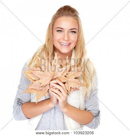 Portrait of beautiful blond girl with dry maple leaves isolated on white background, enjoying autumn season