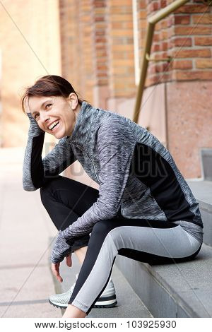Smiling Older Sports Woman Resting Outside