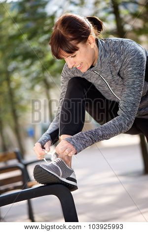 Woman Tying Shoelace Before Workout