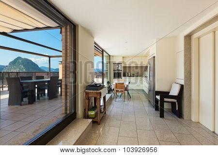 Interior of a modern apartment, domestic kitchen with terrace