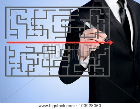 Business man close-up write maze solution