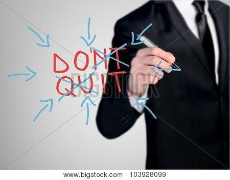 Business man close-up write Do'nt Quit