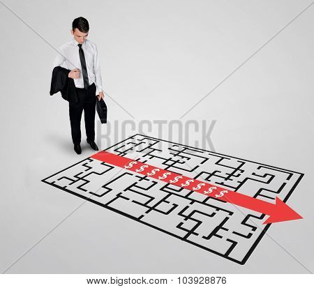 Dollar sign maze and business man thinking solution