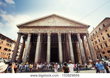 ROME, ITALY - JULY 10, 2015: Tourists visits the ancient Pantheon church, a temple for all Roman Gods on July 10, 2015, Rome, Italy