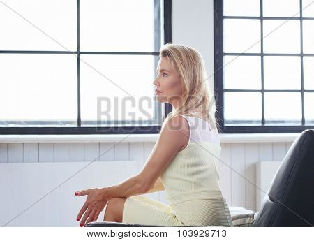 Woman sitting on the sofa at home