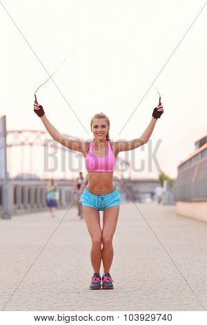 Sport outdoor. Beautiful girl on the street