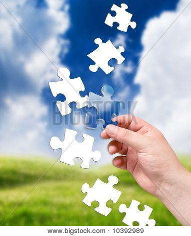 puzzle in human hand