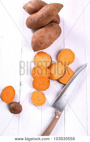 Sweet potato on the wooden table