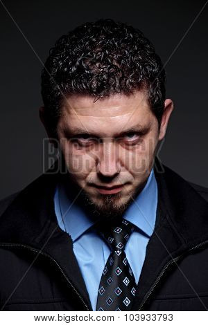 Angry Businessman On Dark Background