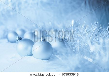 Blue Christmas balls on the white snow