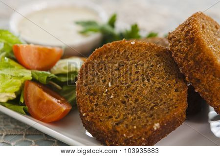 Garlic Croutons With Vegetables, Herbs And Sauce.