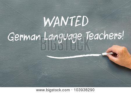Hand Writing On A Chalkboard Wanted German Language Teachers