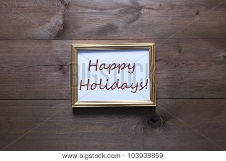 Golden Picture Frame With Copy Space And Text Happy Holidays