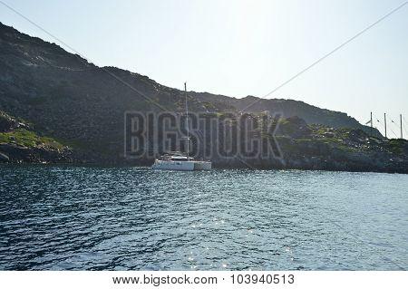 SANTORINI, GREECE - AUGUST 06, 2015: people on yacht near Santorini sea coast. Santorini, is an island in the southern Aegean Sea, about 200 km southeast of Greece's mainland.