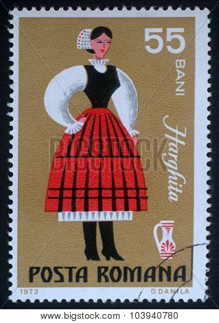 ROMANIA - CIRCA 1973: A stamp printed in Romania shows image of a Harghita woman, from the regional costumes series, circa 1973