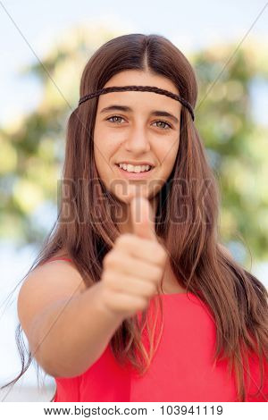 Nice girl twelve year old saying Ok on the street
