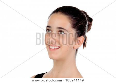 Casual teenager girl smiling looking up isolated on a white background