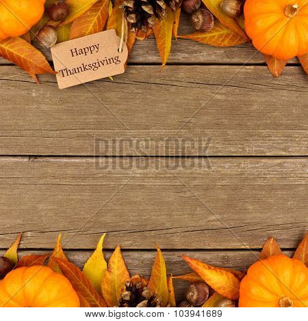 Happy Thanksgiving gift tag with autumn double border over wood