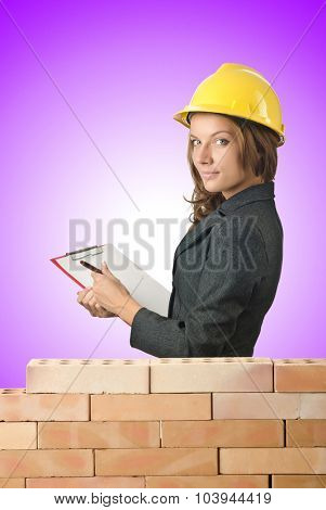 Woman architect near brick wall